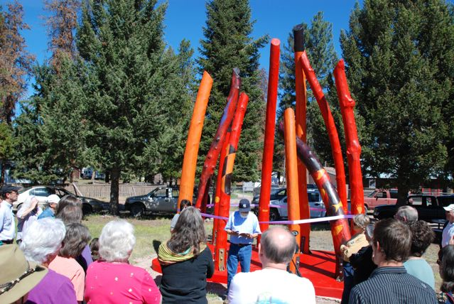 Log Henge Spirits of the Forest, this public artwork located in Seeley Lake, Montana was unveiled by Chief Victor Charlo, leader of the Salish Indian tribe, who read from his poetry book before cutting the ribbon
