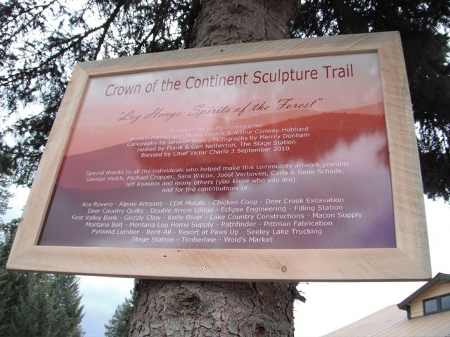 The plaque acknowleging contributors for this Crown of the Continent Sculpture Trail detailing Log Henge - Spirits of the Forest sculpture