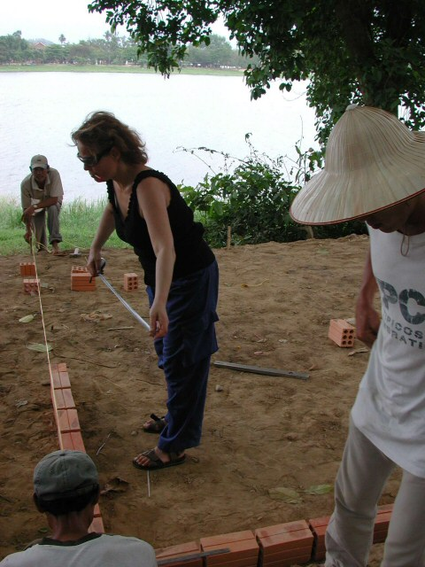 Working the basic foundation line for the first brick wall of this site-specific sculpture in Hue