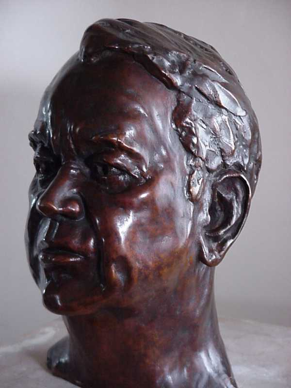 Three quarter profile view of bust of Mr George Warburton - CEO
