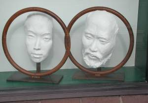Two Ring Face sculptures side by side