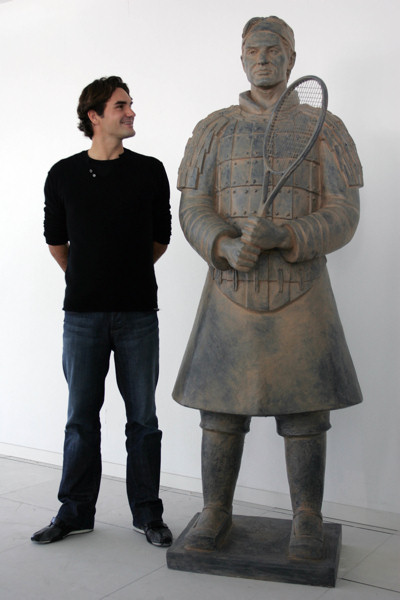 Tennis Master Cup Shanghai qualifier - Number 1 ranking tennis player Roger Federer with his Tennis Terracotta Warrior sculpture in Madrid, October 2007