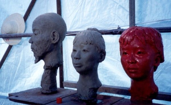 Three of the 10 clay portraits